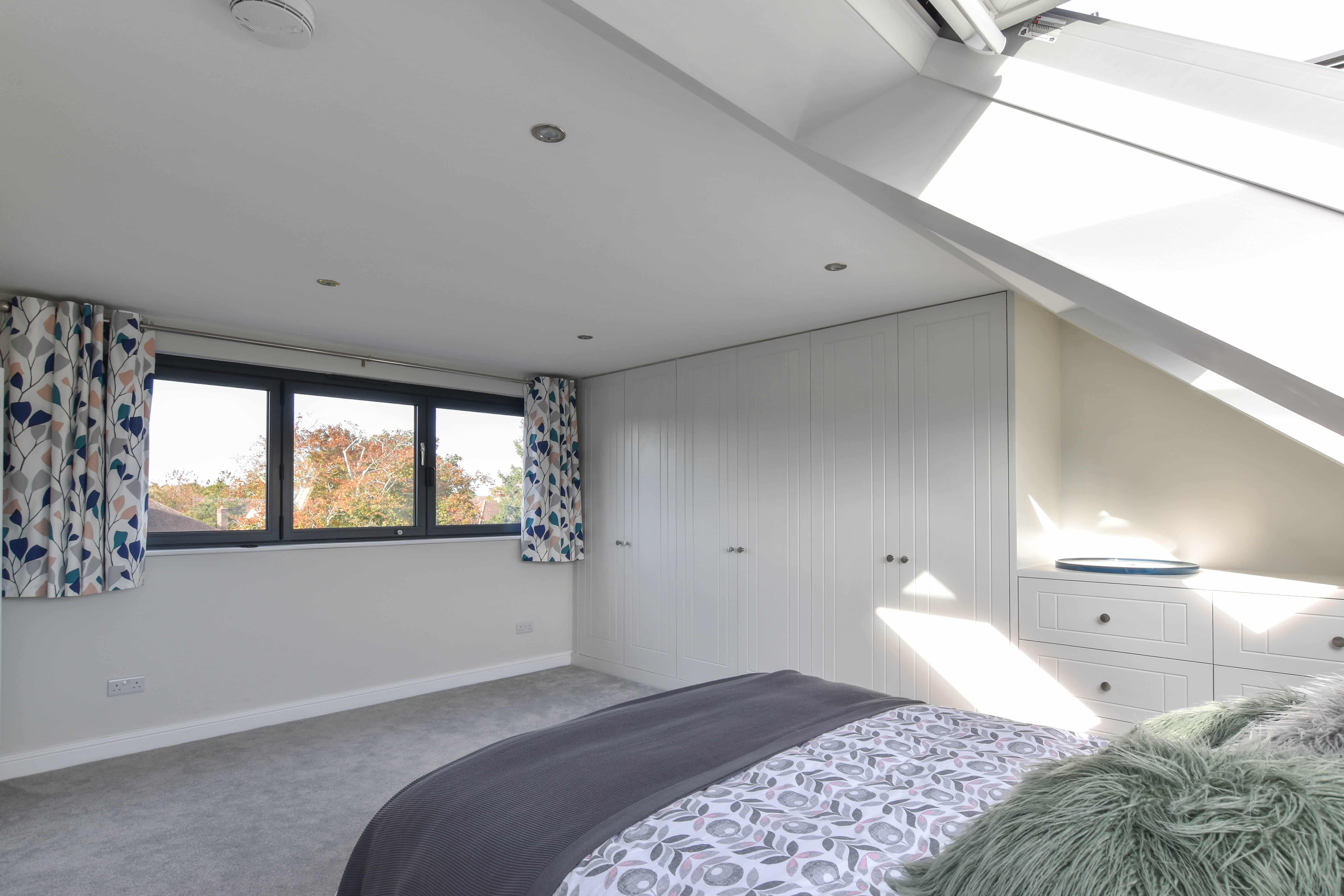 dormer loft extension in hassocks with built in wardrobes and bi fold windows